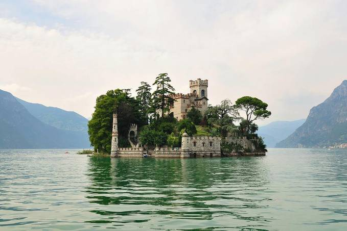 isola di Loreto with neogothic castle around year 900. This castle was built on island the smallest island of the lake, located on the north side of Montisola, Italy. —