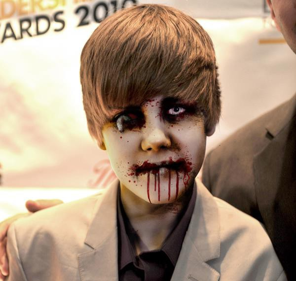 Can you Name the famous Celebrity disguised as a Zombie in this picture?